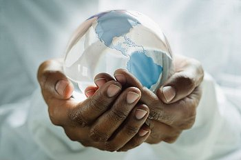 a-pair-of-hands-holding-a-glass-globe-of-the-earth.jpg